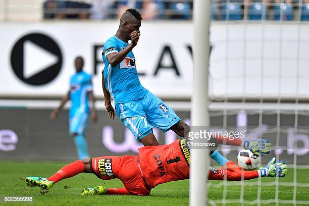 Barry Boubacar Copa goalkeeper of Sporting Lokeren stops an attend of Kalifa Coulibaly forward of KAA Gent during the Jupiler Pro League match...