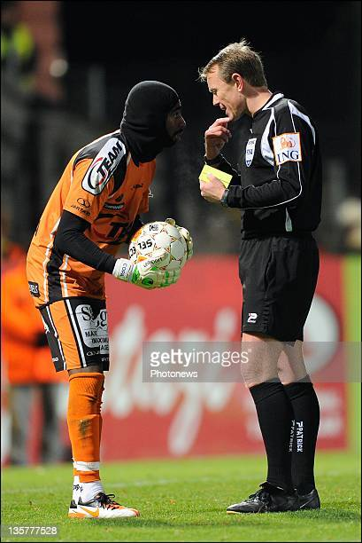 Barry Boubacar Copa of Sporting Lokeren OVL is shown a yellow card by referee Serge Gumieny for wearing a bonnet during the Jupiler Pro league match...