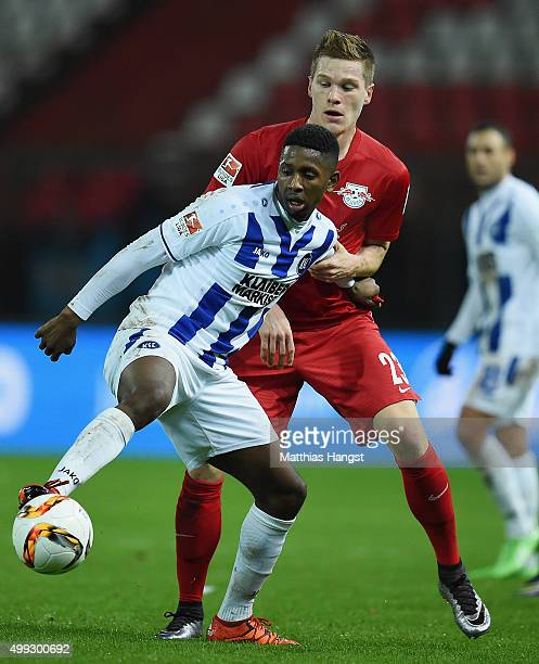 Barry Boubacar of Karlsruhe and Marcel Halstenberg of RB Leipzig compete for the ball during the Second Bundesliga match between Karlsruher SC and RB...