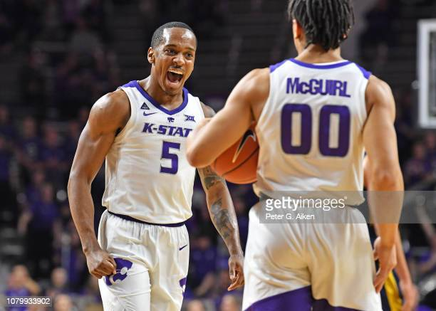 Barry Brown Jr #5 of the Kansas State Wildcats celebrates with Mike McGuirl of the Kansas State Wildcats after a score against the West Virginia...
