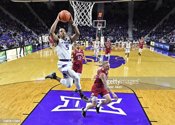 Barry Brown Jr #5 of the Kansas State Wildcats drives to the basket for a dunk against the Denver Pioneers during the second half on November 12 2018...