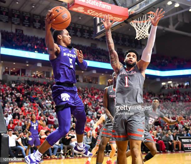 Barry Brown Jr #5 of the Kansas State Wildcats passes the ball from under the basket during the second half of the game against the Texas Tech Red...