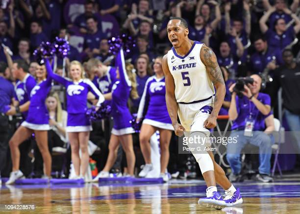 Barry Brown Jr #5 of the Kansas State Wildcats reacts after hitting a three point shot against the Kansas Jayhawks during the second half on February...