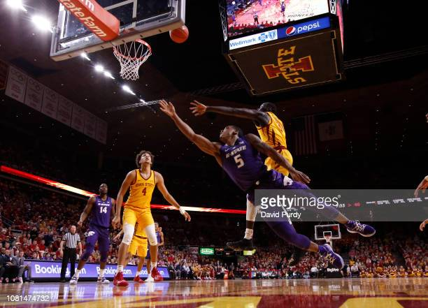 Barry Brown Jr #5 of the Kansas State Wildcats takes a shot as Marial Shayok of the Iowa State Cyclones blocks while George Conditt IV of the Iowa...