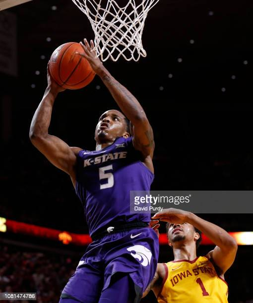 Barry Brown Jr #5 of the Kansas State Wildcats takes the game winning shot over Nick WeilerBabb of the Iowa State Cyclones in the second half of play...
