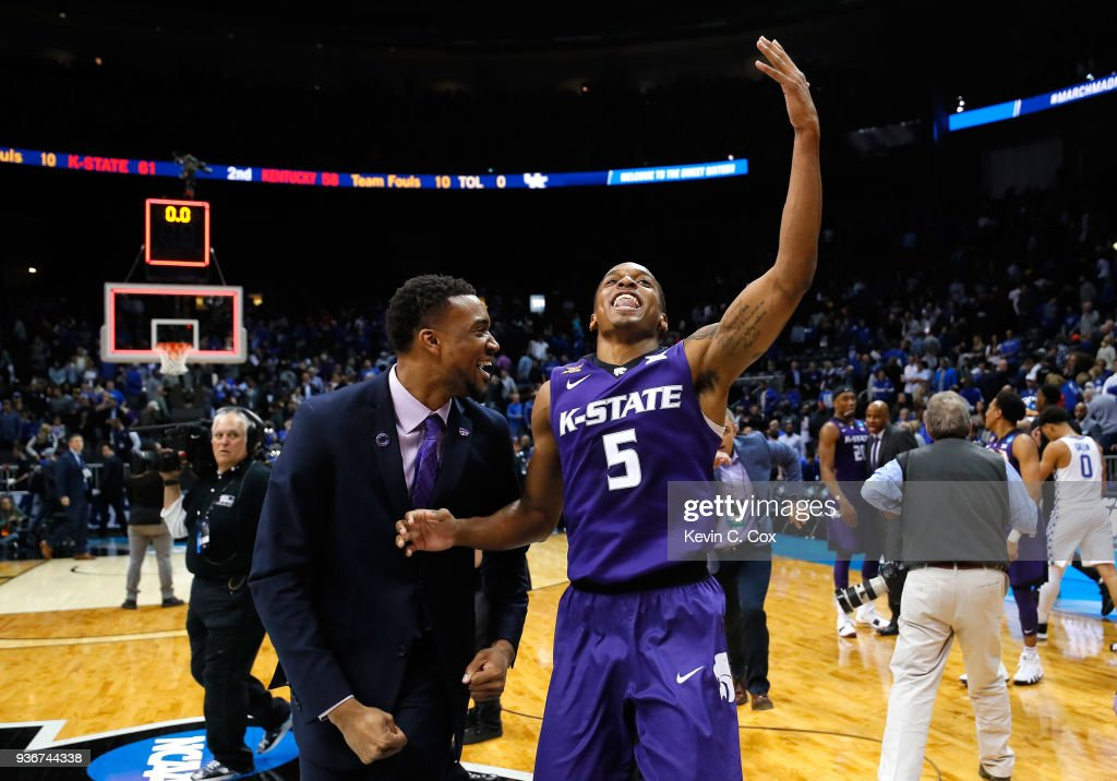 Barry Brown #5 of the Kansas State Wildcats celebrates after defeating the Kentucky Wildcats during the 2018 NCAA Men's Basketball Tournament South Regional at Philips Arena on March 22, 2018 in Atlanta, Georgia. Kansas State defeated Kentucky 61-58.