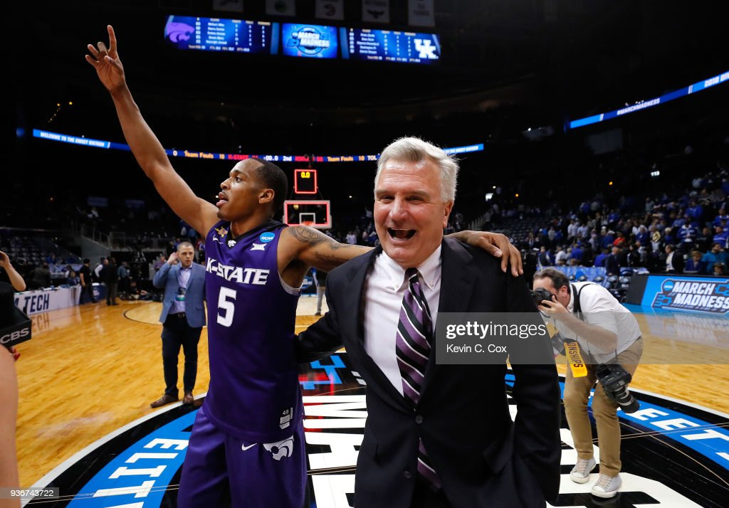 Barry Brown #5 of the Kansas State Wildcats celebrates with head coach Bruce Weber after defeating the Kentucky Wildcats during the 2018 NCAA Men's Basketball Tournament South Regional at Philips Arena on March 22, 2018 in Atlanta, Georgia. Kansas State defeated Kentucky 61-58.