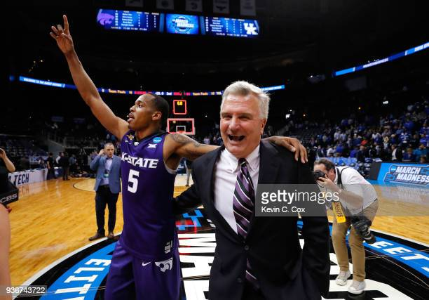 Barry Brown of the Kansas State Wildcats celebrates with head coach Bruce Weber after defeating the Kentucky Wildcats during the 2018 NCAA Men's...