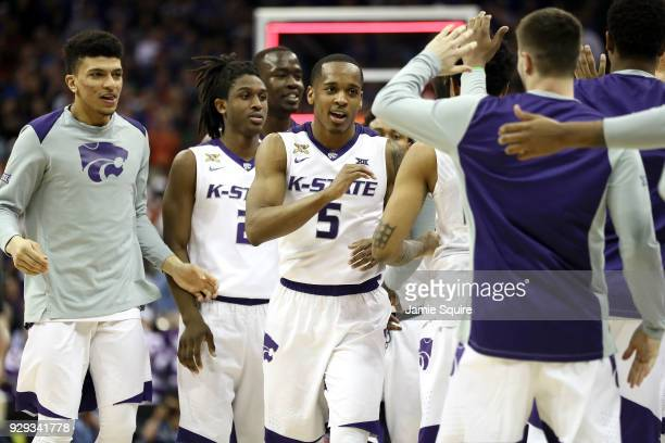 Barry Brown of the Kansas State Wildcats celebrates with teammates after the Wildcats defeated the TCU Horned Frogs in overtime to win the Big 12...