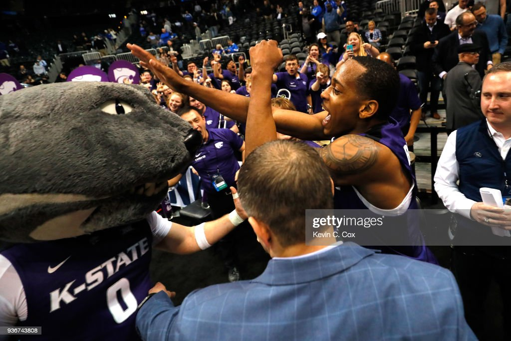 Barry Brown #5 of the Kansas State Wildcats celebrates with the team mascot after defeating the Kentucky Wildcats during the 2018 NCAA Men's Basketball Tournament South Regional at Philips Arena on March 22, 2018 in Atlanta, Georgia. Kansas State defeated Kentucky 61-58.
