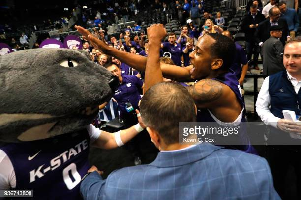 Barry Brown of the Kansas State Wildcats celebrates with the team mascot after defeating the Kentucky Wildcats during the 2018 NCAA Men's Basketball...