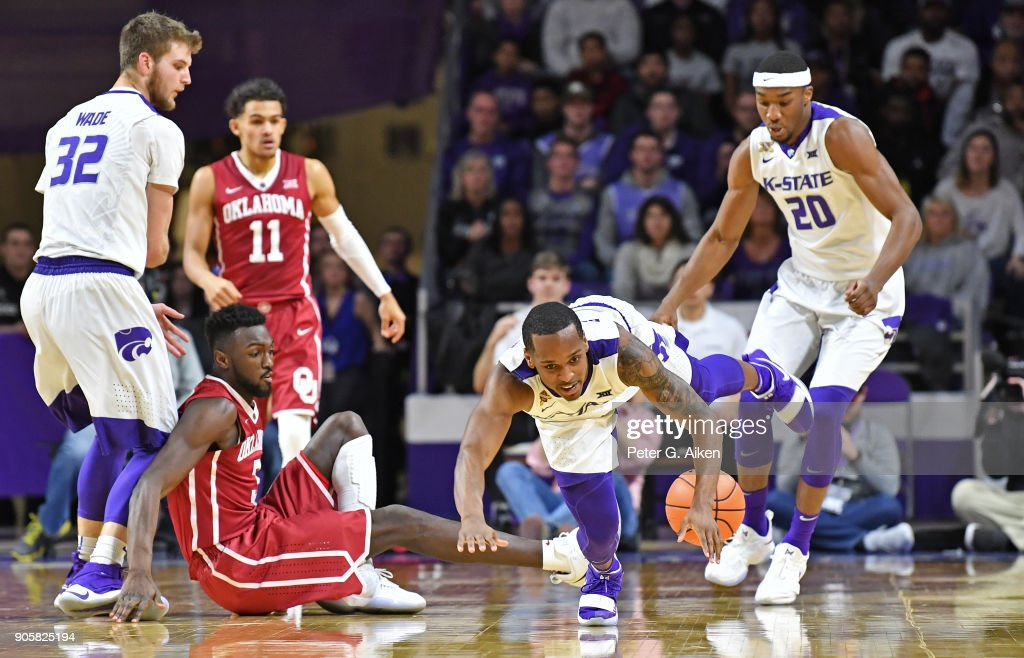 Barry Brown #5 of the Kansas State Wildcats dives for a loose ball against the Oklahoma Sooners during the second half on January 16, 2018 at Bramlage Coliseum in Manhattan, Kansas.