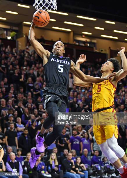 Barry Brown of the Kansas State Wildcats drives in for a dunk against Lindell Wigginton of the Iowa State Cyclones during the second half on February...