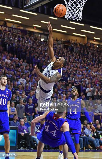 Barry Brown of the Kansas State Wildcats drives to the basket against Mitch Lightfoot of the Kansas Jayhawks during the second half on January 29,...