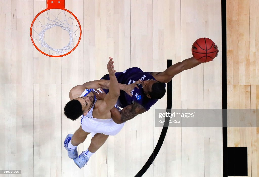 Barry Brown #5 of the Kansas State Wildcats drives to the basket against Sacha Killeya-Jones #1 of the Kentucky Wildcats in the first half during the 2018 NCAA Men's Basketball Tournament South Regional at Philips Arena on March 22, 2018 in Atlanta, Georgia.