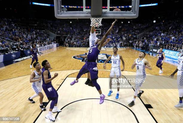 Barry Brown of the Kansas State Wildcats drives to the basket late in the second half for the goahead basket against PJ Washington of the Kentucky...