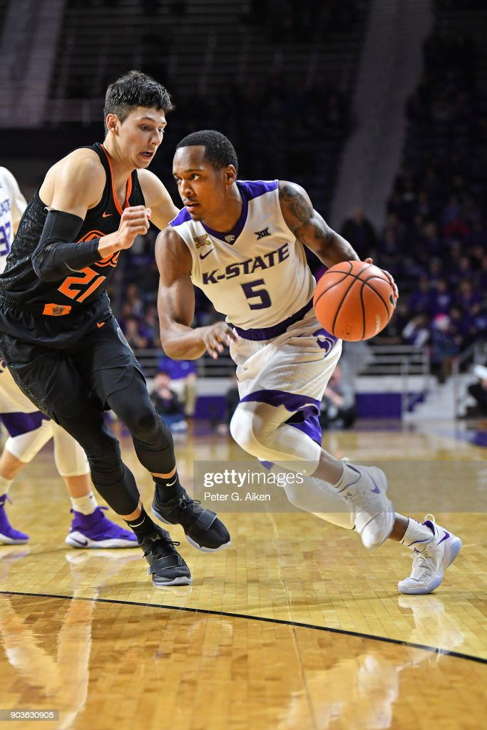Barry Brown #5 of the Kansas State Wildcats drives with the ball against Lindy Waters III #21 of the Oklahoma State Cowboys during the second half on January 10, 2018 at Bramlage Coliseum in Manhattan, Kansas.