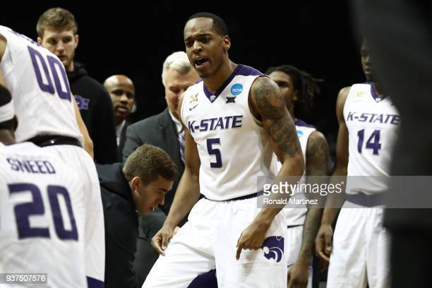 Barry Brown of the Kansas State Wildcats speaks to his team during a timeout in the second half against the Loyola Ramblers during the 2018 NCAA...