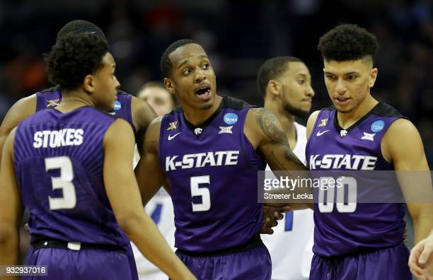 Barry Brown of the Kansas State Wildcats talks to teammates during a timeout against the Creighton Bluejays during the first round of the 2018 NCAA...