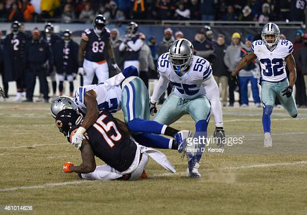 Barry Church of the Dallas Cowboys tackles Brandon Marshall of the Chicago Bears during the second quarter at Soldier Field on December 4 2014 in...