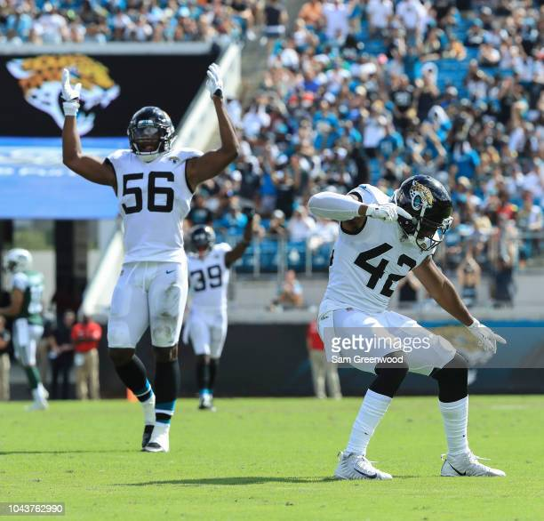 Barry Church of the Jacksonville Jaguars and Dante Fowler Jr #56 of the Jacksonville Jaguars celebrate a play during the second half at TIAA Bank...