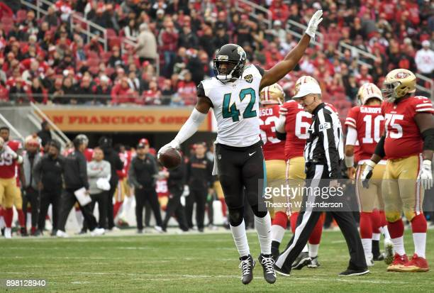 Barry Church of the Jacksonville Jaguars celebrates after intercepting a pass in the endzone against the San Francisco 49ers during their NFL...