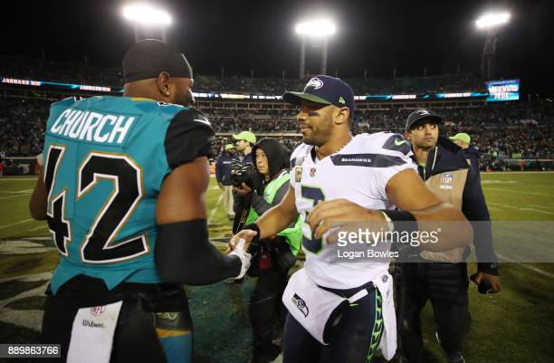 Barry Church of the Jacksonville Jaguars greets Russell Wilson of the Seattle Seahawks after the Jaguars defeated the Seahawks 3024 at EverBank Field...