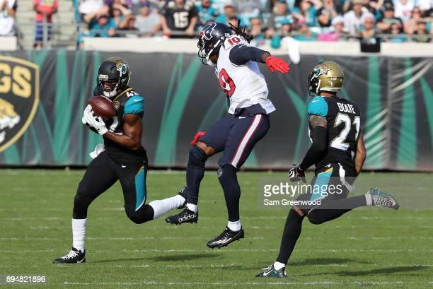 Barry Church of the Jacksonville Jaguars intercepts a pass in front of DeAndre Hopkins of the Houston Texans during the second half of their game at...
