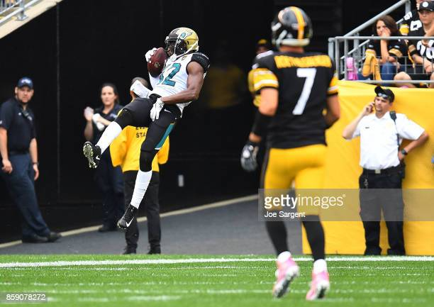 Barry Church of the Jacksonville Jaguars jumps into the end zone for a 51 yard interception returned for a touchdown in the third quarter during the...