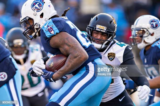 Barry Church of the Jacksonville Jaguars tackles Derrick Henry of the Tennessee Titans at Nissan Stadium on December 31 2017 in Nashville Tennessee...