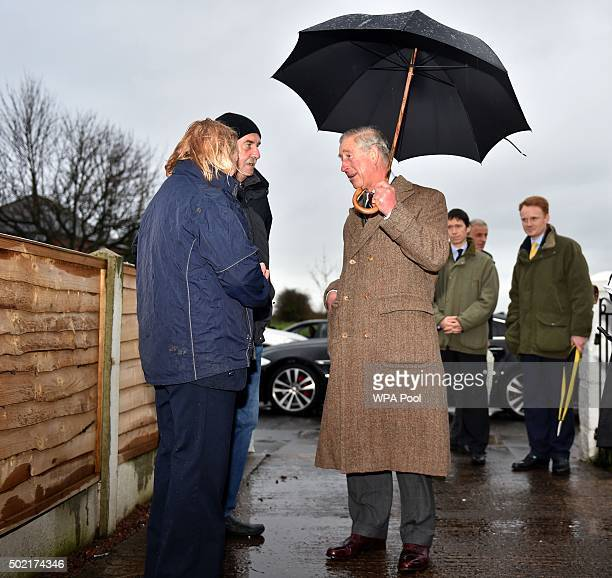 Barry Cookson shows Prince Charles Prince of Wales is shown around his hime which suffered damage during the flooding caused by Storm Desmond in...