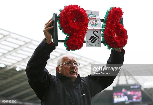 Barry Devonside, father of Hillsborough victim Christopher Devonside carries a wreath as the team's remember the 96 victims of the Hillsborough...
