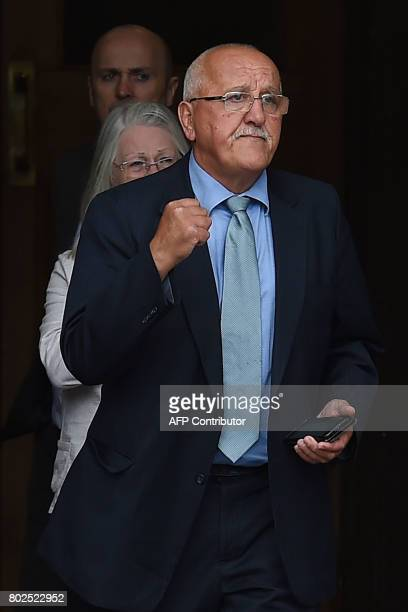 Barry Devonside whose son Christopher died in the 1989 Hillsborough stadium disaster exits Parr Hall with family members after being informed of the...
