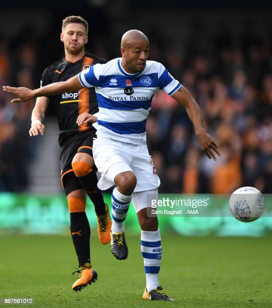 Barry Douglas of Wolverhampton Wanderers and Alex Baptiste of Queens Park Rangers during the Sky Bet Championship match between Queens Park Rangers...