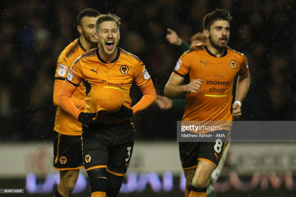 Barry Douglas of Wolverhampton Wanderers celebrates after scoring a goal to make it 2-0 during the Sky Bet Championship match between Wolverhampton and Brentford at Molineux on January 2, 2018 in Wolverhampton, England.