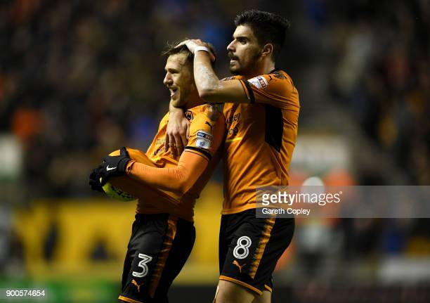 Barry Douglas of Wolverhampton Wanderers celebrates scoring his team's second goal with Ruben Neves during the Sky Bet Championship match between...