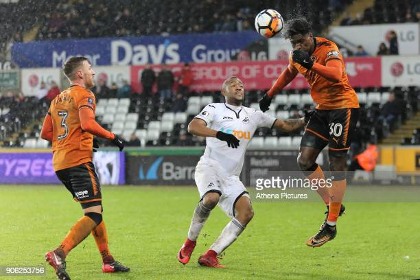 Barry Douglas of Wolverhampton Wanderers heads the ball away from Jordan Ayew of Swansea City during the Emirates FA Cup match between Swansea and...