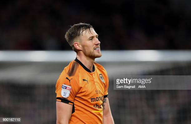 Barry Douglas of Wolverhampton Wanderers stands dejected during the Sky Bet Championship match between Aston Villa and Wolverhampton Wanderers at...