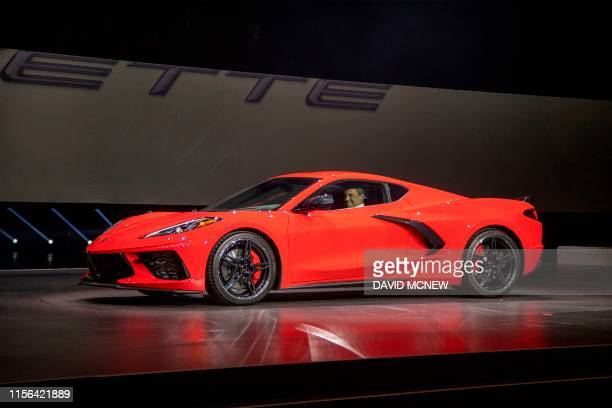 Barry Engle executive vice president and president of General Motors International drives onstage in the new 2020 Corvette Stingray during the Next...