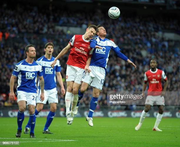 Barry Ferguson of Birmingham City and Laurent Koscielny of Arsenal both go for a high ball during the Carling Cup Final between Arsenal and...