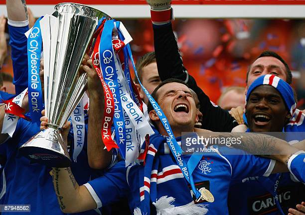Barry Ferguson of Rangers celebrates winning the Scottish Premier League trophy after the Scottish Premier League match between Dundee United and...