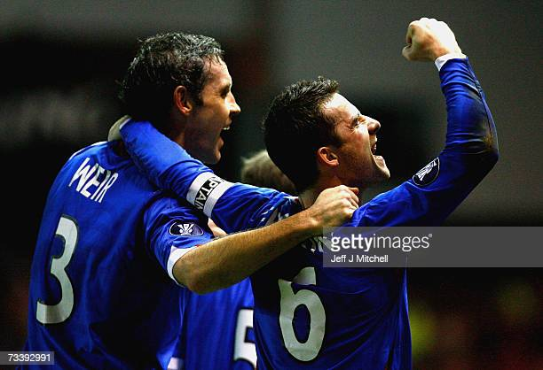 Barry Ferguson of Rangers celebrates with David Weir after scoring during the UEFA Cup first knock-out round, second leg match between Rangers and...
