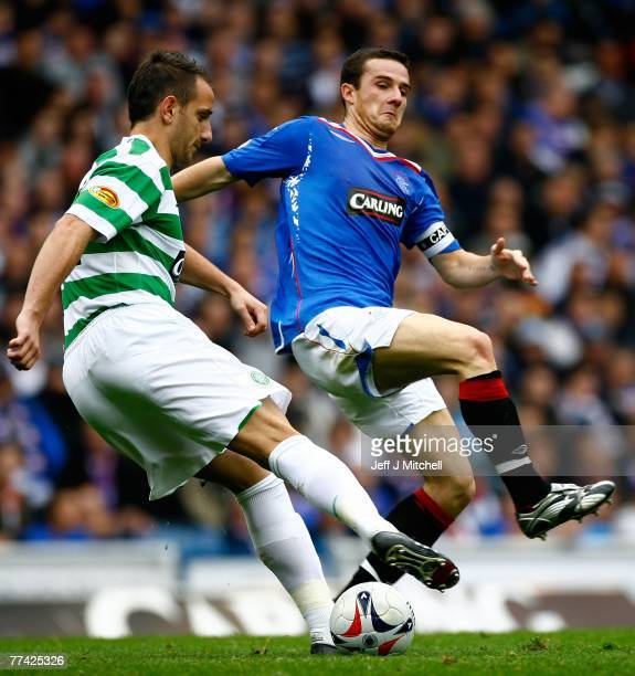Barry Ferguson of Rangers is tackles John Kennedy of Celtic during the Scottish Premier League match between Rangers and Celtic at Ibrox Stadium on...
