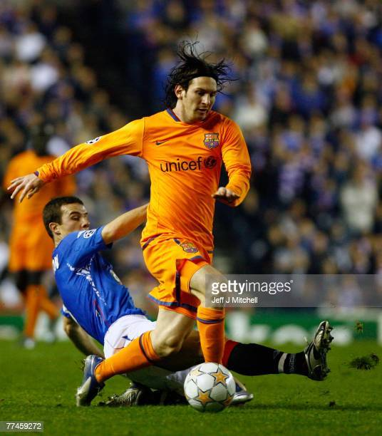 Barry Ferguson of Rangers tackles Lionel Messi of Barcelona during the UEFA Champions League Group E match between Rangers and Barcelona at Ibrox...