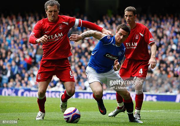 Barry Ferguson of Rangers tackles Scott Severin of Aberdeen during the Scottish Premier League match between Rangers and Aberdeen at Ibrox Stadium on...