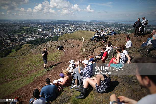 Barry Ferns AKA Lionel Richie performs a 15 minute act at the summit of Arthur's Seat during in the Edinburgh Fringe Festival on August 8 2012 in...