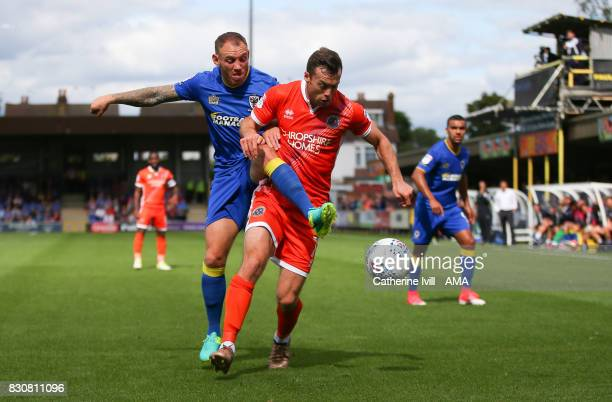 Barry Fuller of AFC Wimbledon and Shaun Whalley of Shrewsbury Town during the Sky Bet League One match between AFC Wimbledon and Shrewsbury Town at...