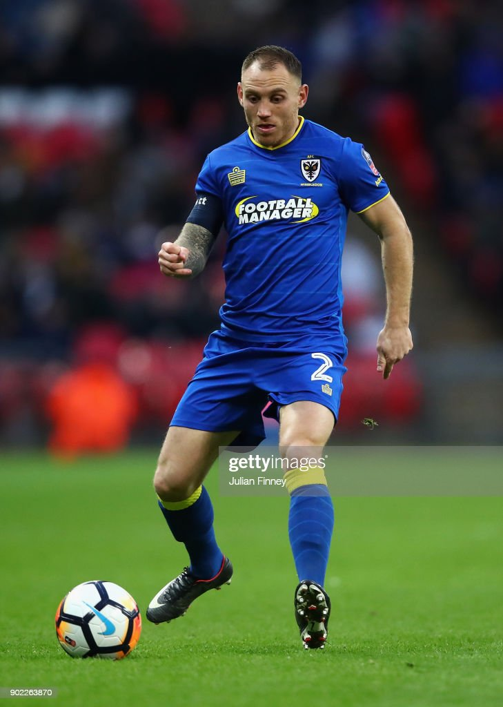 Barry Fuller of AFC Wimbledon in action during The Emirates FA Cup Third Round match between Tottenham Hotspur and AFC Wimbledon at Wembley Stadium on January 7, 2018 in London, England.