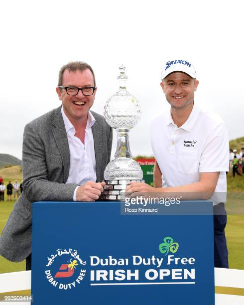 Barry Funston Cheif Executive of the Rory Foundation and Russell Knox of Scotland after his playoff win in the final round of the Dubai Duty Free...