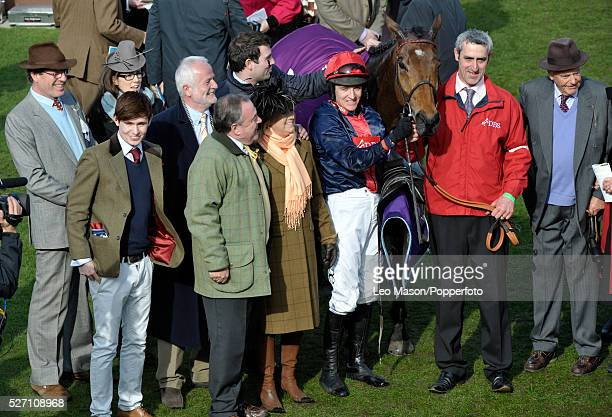 Barry Geraghty and Bobs Worth with the owners syndicate in the unsaddling enclosure after winning the RSA Chase during the 2012 Cheltenham National...